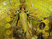 foto of durga  - A typical Durga Idol embellished with beautiful golden papercraft - JPG
