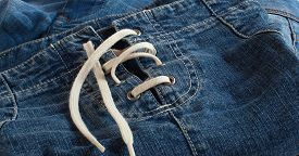 pic of jeans skirt  - Blue jeans skirt with lacing close up - JPG