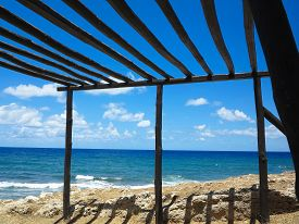 pic of canopy roof  - Old wooden canopy on the sea coast and blue sky in Greece - JPG
