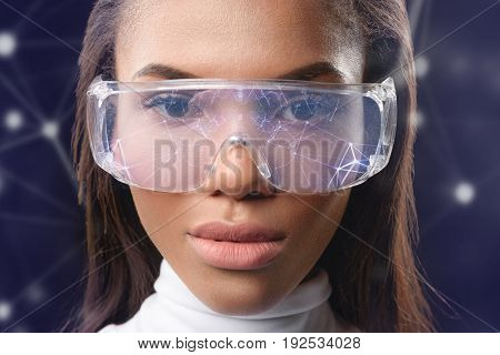 All social network connection in my eyes. Close up portrait of confident african woman wearing smart futuristic eyewear