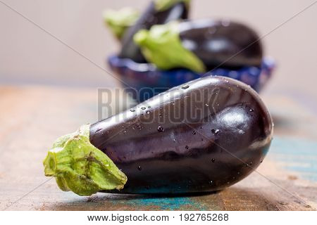 poster of Ripe Raw Purple Eggplants On A Wooden Background