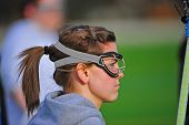 stock photo of teen pony tail  - Profile of a teenage girl wearing lacrosse protective eye goggles - JPG