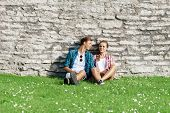 Young and happy couple chilling in park. Love, relationship, romance concept. poster