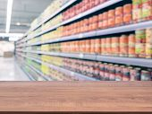 Blurred Colorful Supermarket Products On Shelves poster