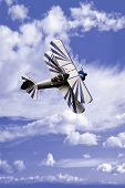 picture of aerobatics  - An aerobatic airplane against a cloudy sky - JPG