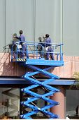 stock photo of building exterior  - Workers cleaning glass - JPG