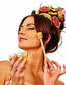 Honey facial mask with fresh fruits for hair and skin on woman head. Girl face hold honeycombs for h poster