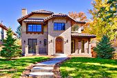 Photo of all brick, two story luxury home in denver, colorado, united states.
