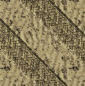 pair of tye tracks go across the desert or beach sand