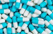 Top View Pile Of Blue And White Antibiotic Capsule Pills Texture. Pharmaceutical Production. Global  poster