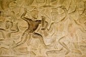 picture of asura  - Ancient Khmer bas relief carving of gods fighting demons - JPG