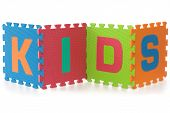 Kids - Sign With Alphabet Puzzle Letters Isolated On White Background