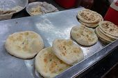 Naans Placed On A Tray Before Serving As Street Food. Naan Is A Leavened, Oven-baked Flatbread Found poster