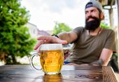 He Has The Bad Habit Of Drinking Too Much Beer. Chilled Beer Mug On Table. Bearded Man Drinking Beer poster