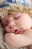 pic of newborn baby  - Close up of sleeping newborn baby in woollen hat - JPG