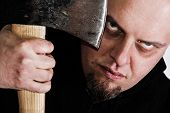 stock photo of serial killer  - Serial killer with axe and mad gaze - JPG