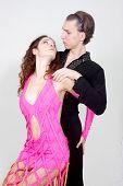 studio shot of young couple dancing latino
