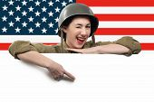 Young Woman Dressed In American Ww2 Military Uniform Showing Empty Blank Signboard With Copy Space poster