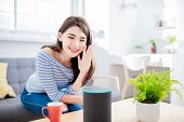 Smart Ai Speaker Concept - Young Woman Talk To Voice Assistant At Home And Feel Happy poster