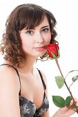 foto of underthings  - Portrait of young woman holding rose isolated on white - JPG