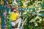 Young Adult Male Man Climber With Protective Sport Equipment And Helmets Climbs And Enjoys Active Le poster