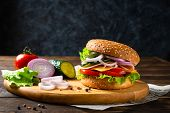 Homemade Cheese Burger Or Hamburger On Wooden Board. Copy Space. Fast Food For Breakfast Or Lunch poster