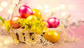 Easter colorful eggs in the basket. Beautiful colorful yellow and orange color eggs with decorations poster