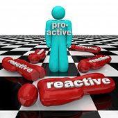 One person stands as winner on a chessboard with the word Proactive across his chest while many othe