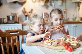 Funny Kids Are Eating, Tasting Italian Homemade Pizza In Kitchen. Child Is Capricious, Disgusted By  poster