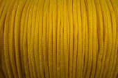 The Yellow Rope Is Reeled Up On The Coil In Shop. A Saving Or Safety Rope For Climbers. Texture Of A poster