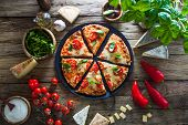 Pizza On Wood With Ingredients. Pizza With Cheese, Tomatoes And Basil. Rustic Italian Pizza poster