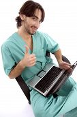 Doctor Working On Laptop Wishing Goodluck
