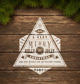 Painted wooden background with a vintage typography sign and Christmas fir tree. Vector Illustration