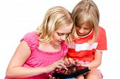 Two Girls Using Tablet Isolated Over White