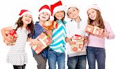 Group of children with Christmas presents - isolated over a white background