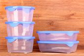 pic of tupperware  - Plastic containers for food on wooden background - JPG