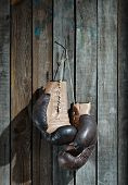 Brown old boxing gloves wooden wall