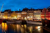 Boats At The Harbor In Nyhavn At Night