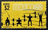 MEXICO - CIRCA 1968: a stamp printed in the Mexico shows weightlifting 19th Olympic Games Mexico Cit