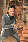 image of masker  - Man at Lumber or timber with mask on his neck - JPG