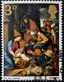 UNITED KINGDOM - CIRCA 1967: A stamp printed in Great Britain shows The Adoration of the Shepherds S