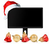 Liquid-crystal monitor and Santa Claus hat isolated