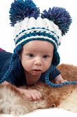 Little baby in pom-pon hat