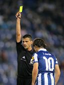 BARCELONA - NOV, 10: Referee Jesus Gil Manzano delivers yellow card during a Spanish League match be