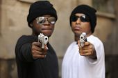 Gang members on the street, focus on guns