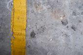 Grunge Textured Concrete Floor With Yellow Line