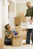Couple unpacking in new house