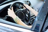 Close up of woman hands driving a car