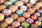 stock photo of casket  - Various of different colorful jewel boxes in Indian market - JPG