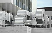 stock photo of pipeline  - Industrial air conditioning and ventilation systems on a roof - JPG